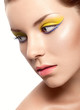 beautiful girl with a bright lemon-colored make-up