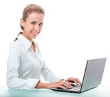 friendly administrative assistant at the desk with a laptop