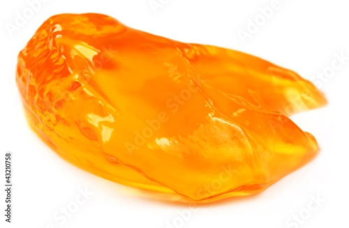 Piece of orange jelly over white background