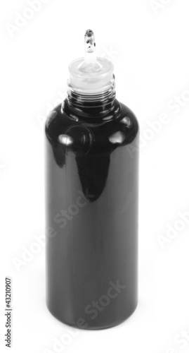Ink bottle over white background