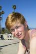 smiling attractive boy at the beach promenade