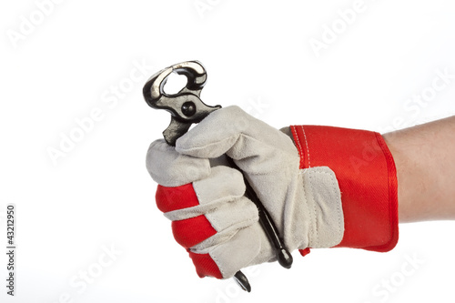 Hand with protection glove holding pincer