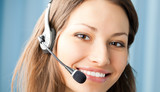 Cheerful smiling support phone operator at office