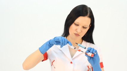 Close-up of a woman doctor with syringe