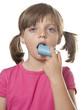 little girl with inhaler - respiratory problems .