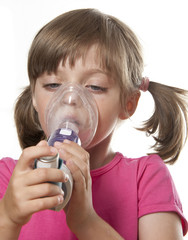 ill little girl with inhaler - respiratory problems