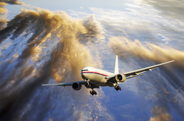 airliner and dramatic sunset with ocean.between clouds