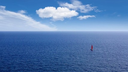 sailboat sailing in deep mediterranean sea offshore