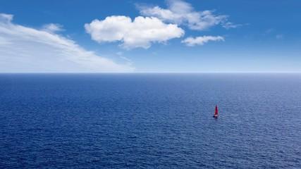sailboat sailing in deep mediterranean sea offshore