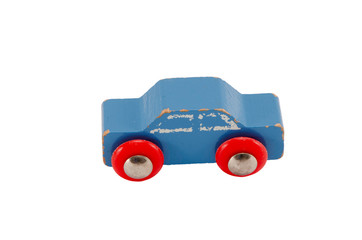 Wooden blue vintage toy car isolated on white