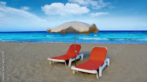 idyllic shore beach turquoise water hammock and parasol