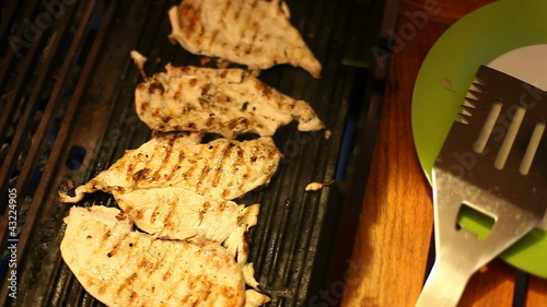 Grilling chicken breast on the barbecue