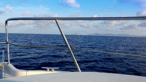 boat sailing in blue mediterranean sea on ibiza islands