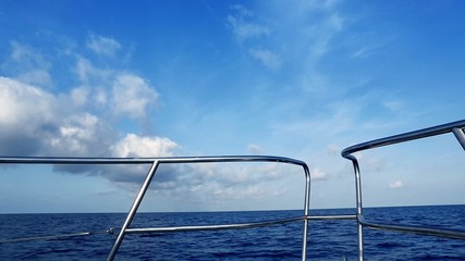 Boating in blue ocean sea view from boat bow deck