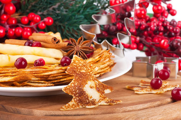 Pancakes with christmas berries and pastry