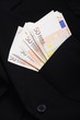 Pile of money fifty euros banknotes in pocket of a asuit