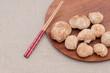 Leinwandbild Motiv Monkey head mushroom on a wooden plate