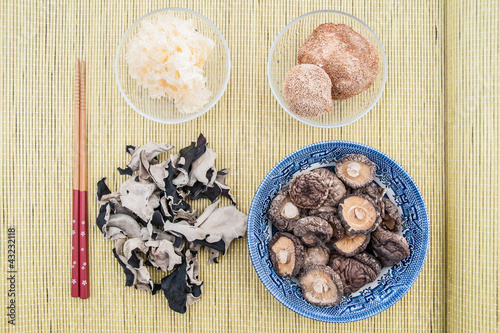 Assorted chinese mushrooms on bamboo background