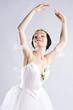 Beautiful ballerina posing on grey