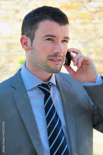 handsome man calling by phone