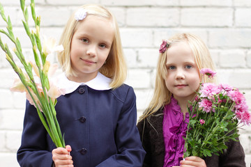 Girls with flowers - first day of school