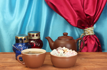 Teapot with cup and saucer with  sweet turkish delight