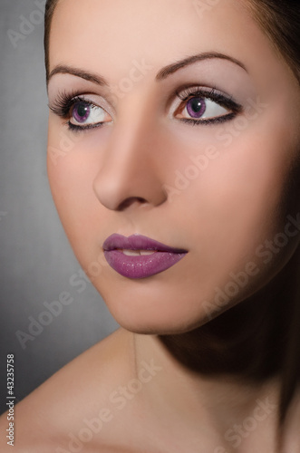 Portrait of beautiful girl with violet eyes