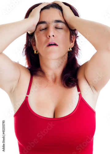 Very stressed hispanic woman with a headache isolated on white