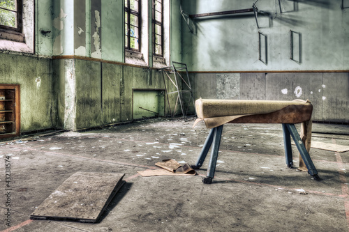 Dilapidated pommel horse in an abandoned school gymnasium - 43238574