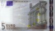 Five euro note with light rays passing though it.