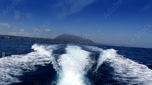 Boating in blue ocean sea view from boat ibiza background