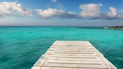 beach wooden pier turquoise sea Formentera Balearic islands