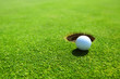 Leinwandbild Motiv golf ball on lip of cup
