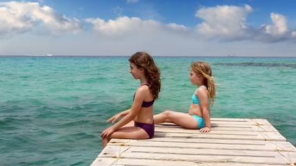 little sisters girls looking idyllic beach landscape