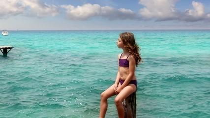beautiful little girl tanning in ibiza  formentera beach