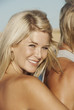 Blond woman smiling at the beach
