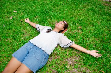 Thai girl sleep on the ground,emancipate,free,liberate