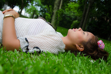 Thai University Student Sleep Happily On Grassland