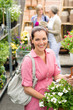 Garden centre woman hold white potted hibiscus