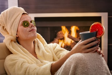Woman relaxing in facial mask