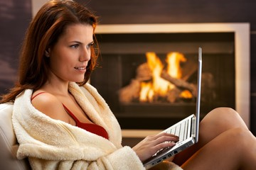 Sexy woman using computer in winter