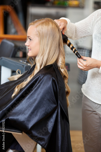 Woman At Parlor Making Her Hair Curly