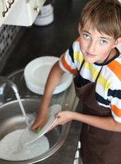 boy doing the dishes
