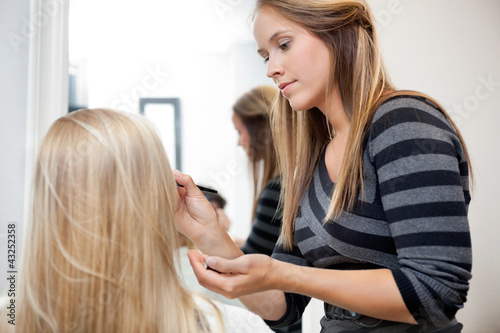 Artist Applying Make Up To Woman