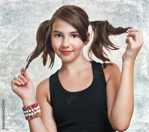 400 F 43253300 eDtSaBPmNgsHuezlRT34N9VGMN4chorC A beautiful teen girl in black top holding her pigtails