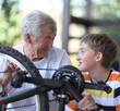 Grandfather and grandson of a bicycle repair