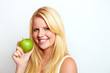 beautiful young blond smiling girl with green apple