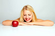 beautiful young blond smiling girl with red apple