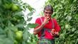 Organic Farmer in Greenhouse