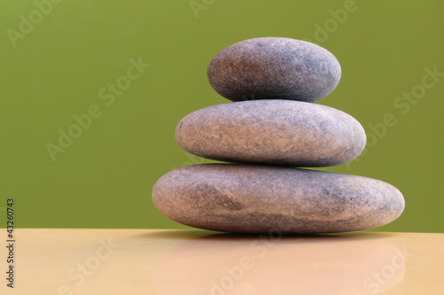 Three stones on a green background - harmony, stability